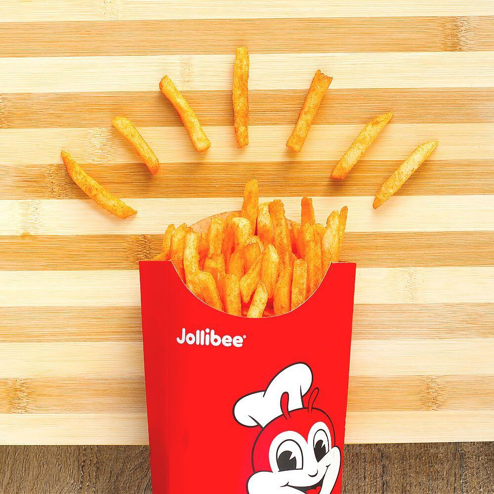 jollibee french fries Apart from the food package that we chose for the party, we decided to add a few orders of large fries because when it comes to french fries, more is more 🙂 for our souvenirs/giveaways, i decided to make a jollibee logo using some white chocolate, dark chocolate and food coloring.