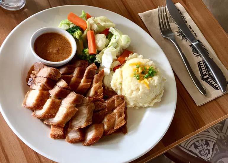 Pork. mashed potato, and vegetables from Cafe Del Mar