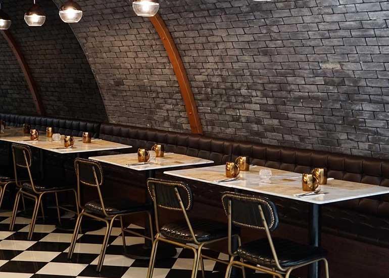 brick walls, checkered floor, rustic
