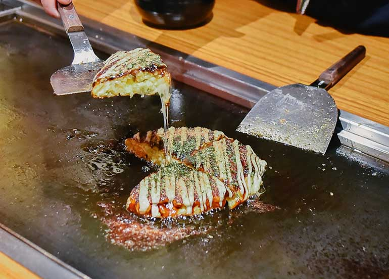 Okonomiyaki on a Griddle at Dohtonbori