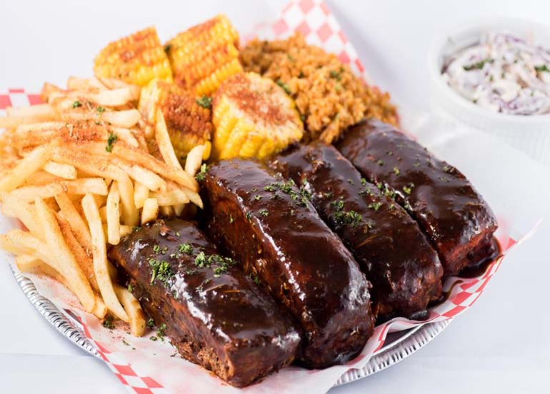 Feast of Ribs and Sides from Rue Bourbon