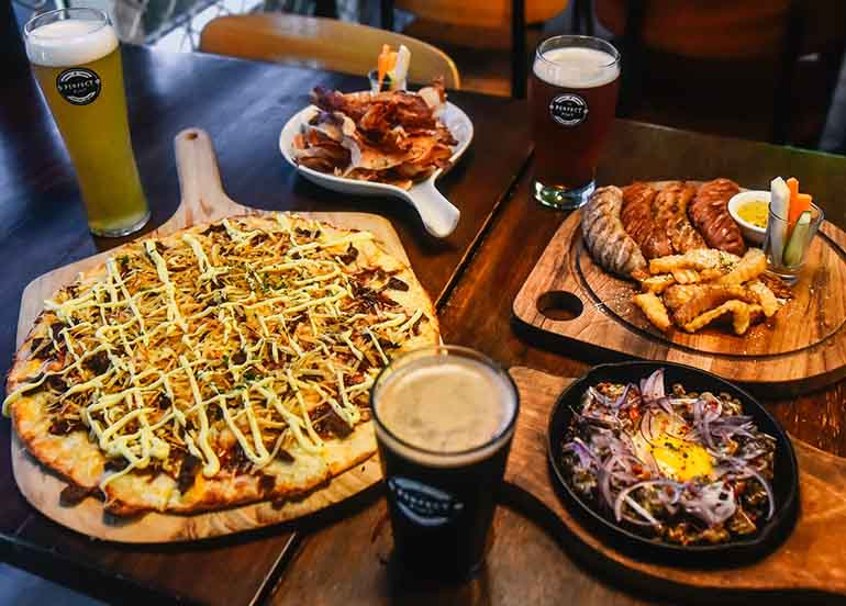 Sisig, Sausage Platter, Beer, Cheesesteak Pizza from The Perfect Pint