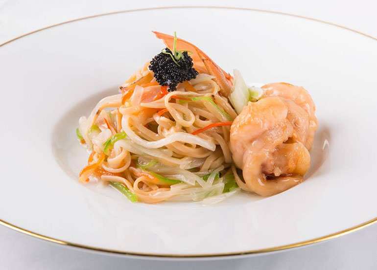 Braised E-fu Noodles with Chinese cabbage, Mushrooms and King Prawns from Crystal Dragon