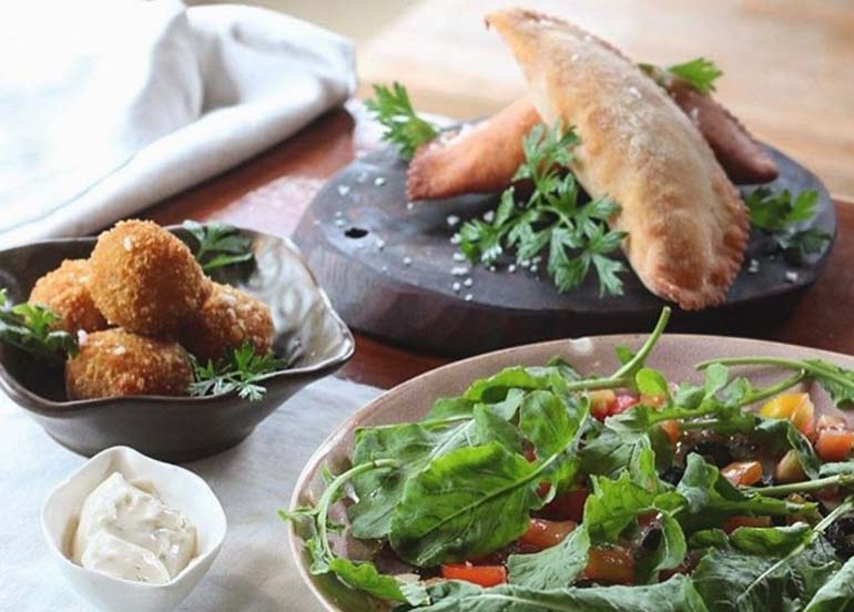 Empanada, Potato Balls, and Salad from La Carinderia