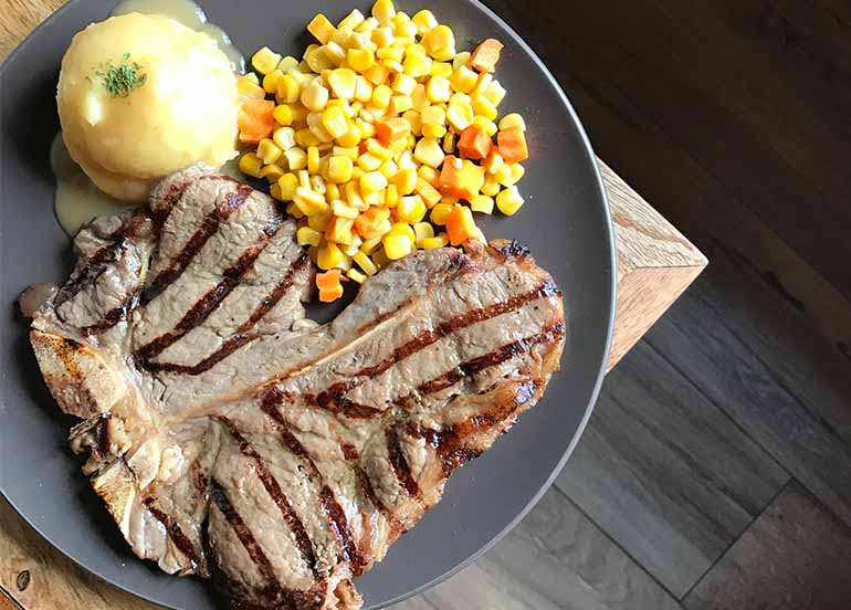 Original Porterhouse Steak with Mashed Potato, Corn, and Carrots from Blake's Wings and Steaks