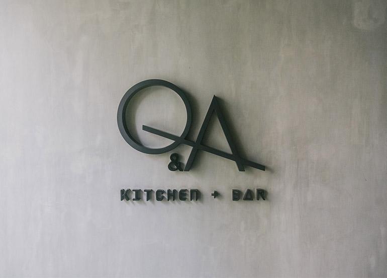 Q & A Kitchen + Bar Logo