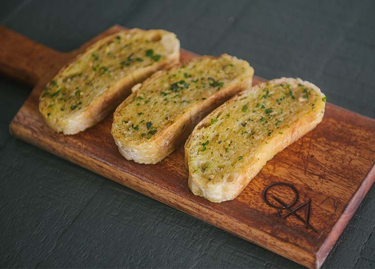 Ciabatta with Calabrian Chili Butter from Q & A Kitchen + Bar