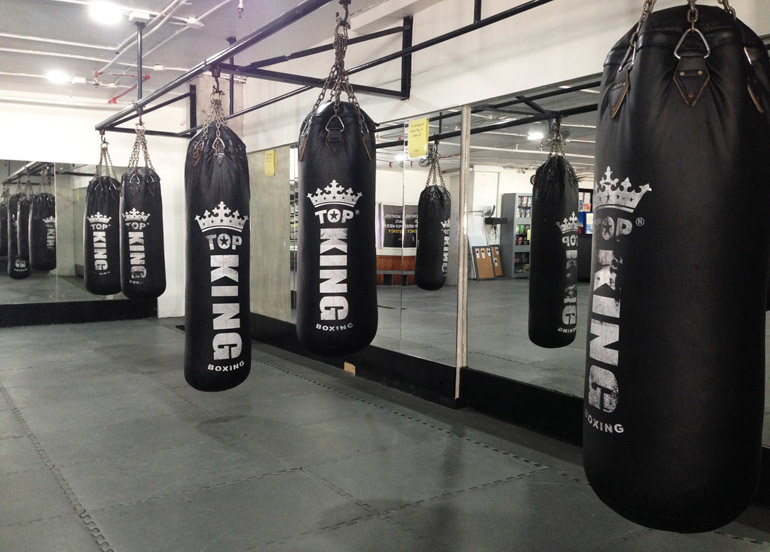 Punching Bags in Gym Interior