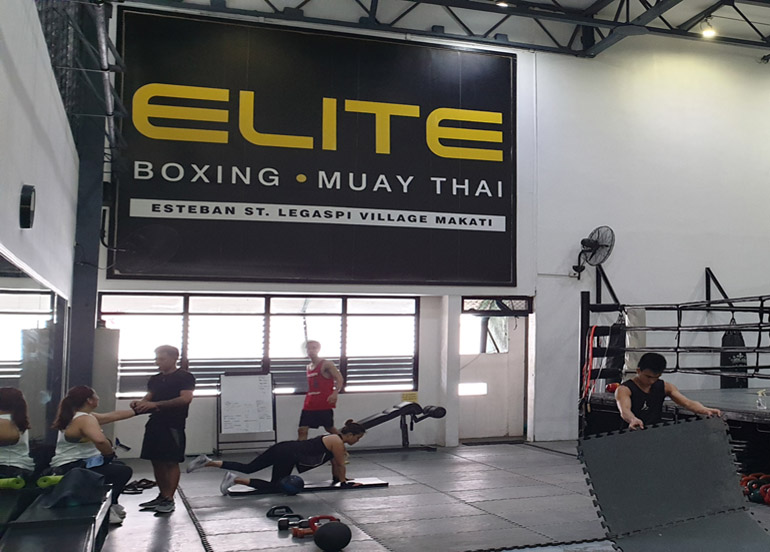 Elite Boxing and Muay Thai Interior with clients and professionals