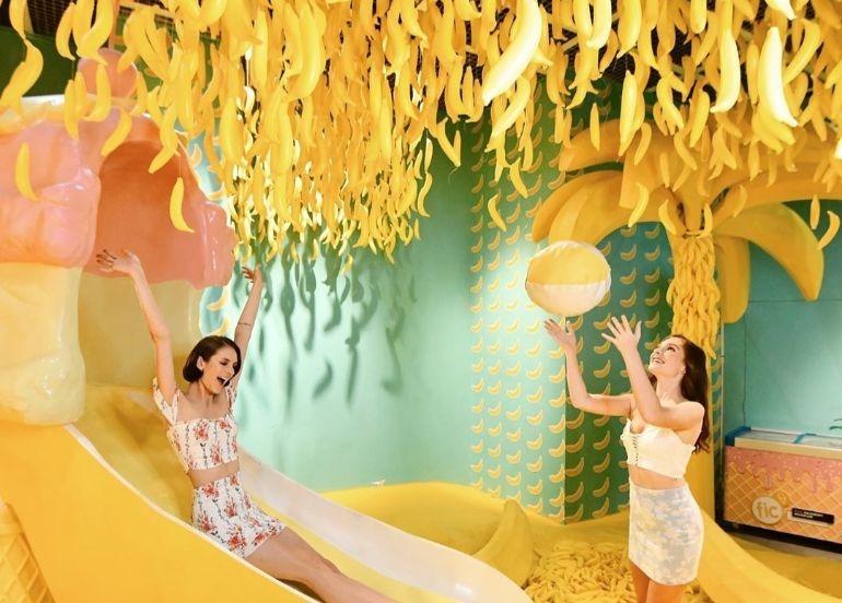 banana-beach-room-girls-play-bananas-hanging-yellow-slide-dessert-museum