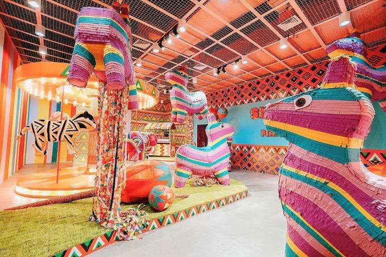 pinata-pit-room-interior-colorful-giant-pinata-carousel-dessert-museum