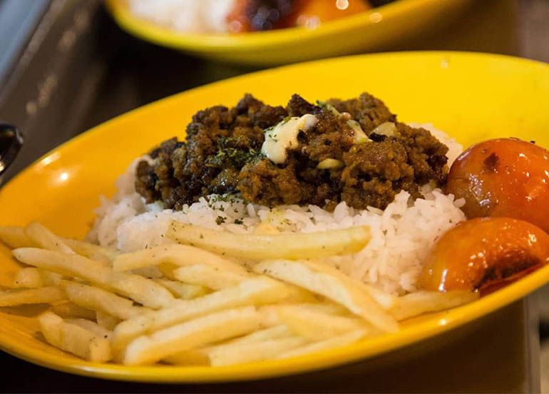 Keema Meal (marinated beef over rice, french fries, grilled tomatoes) from Kebab Bob