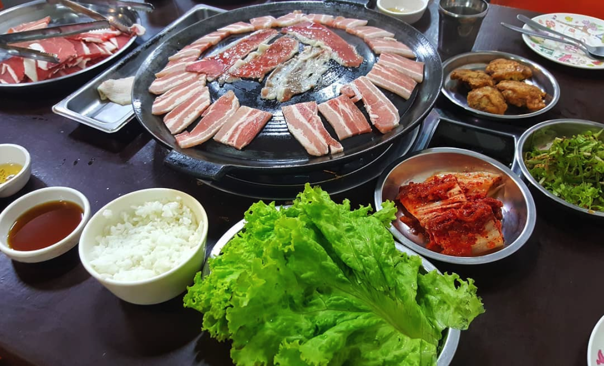 Display of meat assortments as well as side dishes and rice
