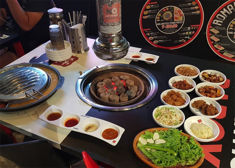 Side dishes on display with piping grill