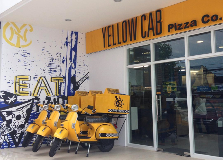 Yellow Cab Delivery Motorcycles in front of the establishment