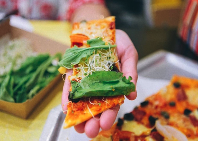 Original Dear Darla Pizza from Yellow Cab with Arugula and alfalfa sprouts