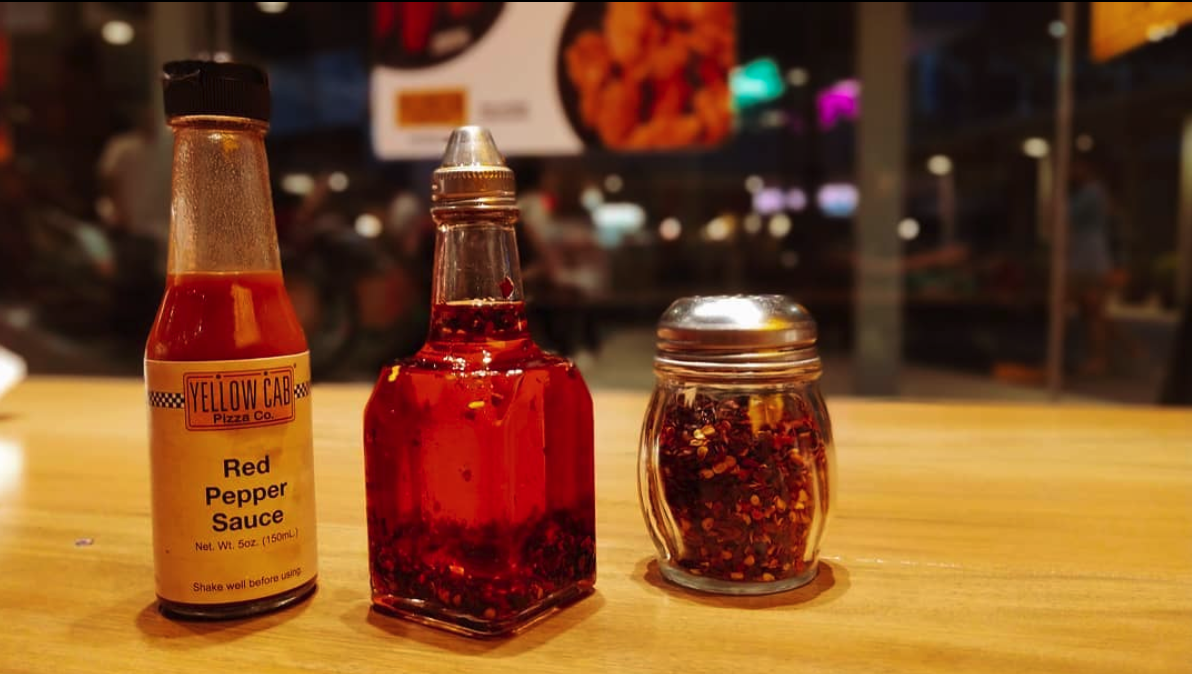 Red Pepper Sauce, Hot Oil, and Hot Pepper Flakes from Yellow Cab