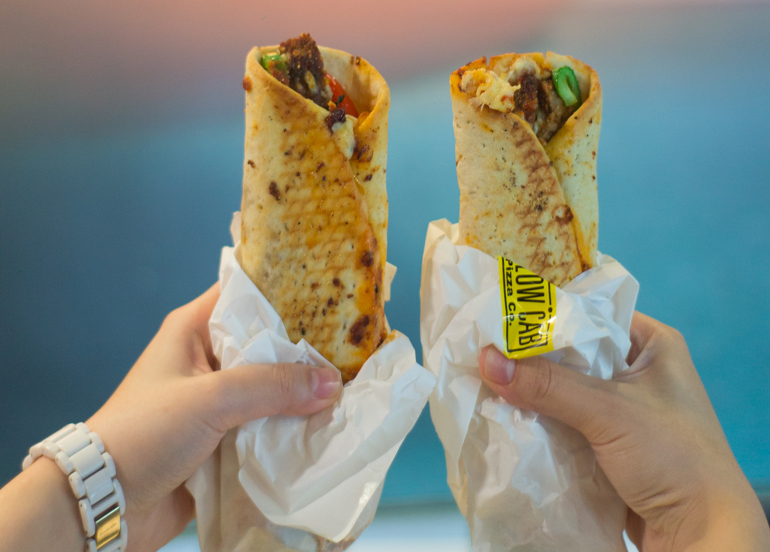 Hands holding Two MyWraps from Yellow Cab