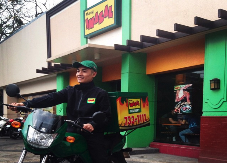 Mang Inasal Delivery Man in front of the establishment