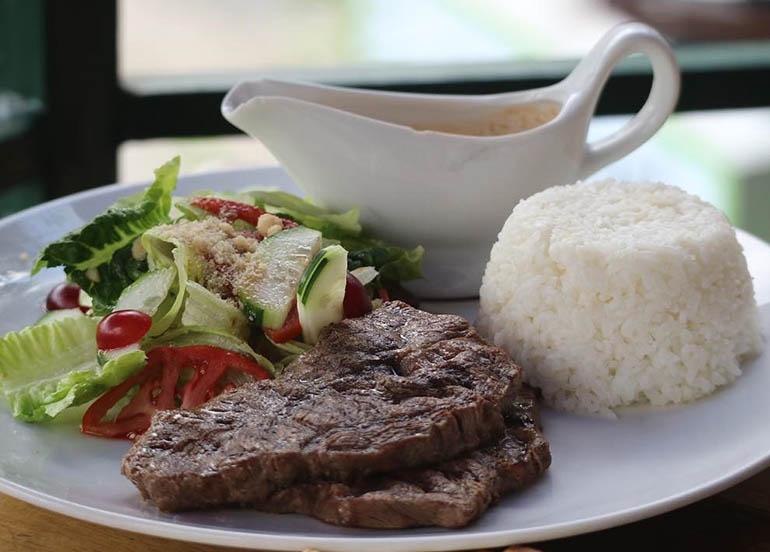 Steak, Veggies, Gravy, and Rice from Secret Garden Resto & Cafe Co.