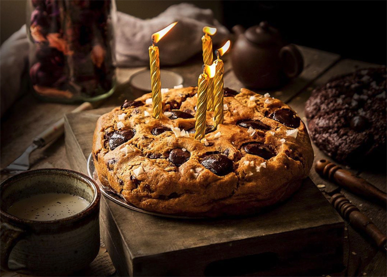 Ollie's Kitchen Celebration Chocolate Chip cookie cake topped with four candles