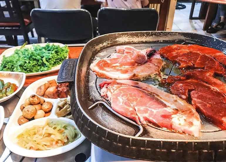 Korean BBQ meat and banchan from Gangnam Style Korean Restaurant