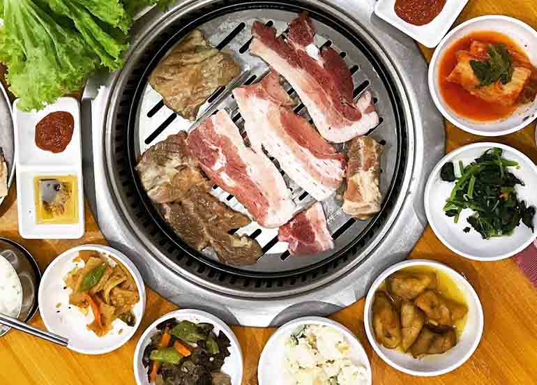 KBBQ and Side Dishes like Kimchi and Sweet Potato from Dong Won Korean Garden
