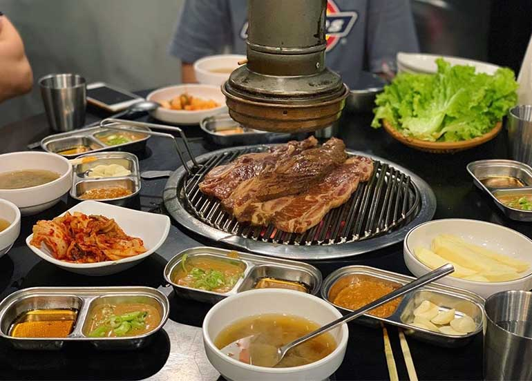 Korean BBQ Grill and Banchan like Kimchi, Lettuce and Soup from Makchang