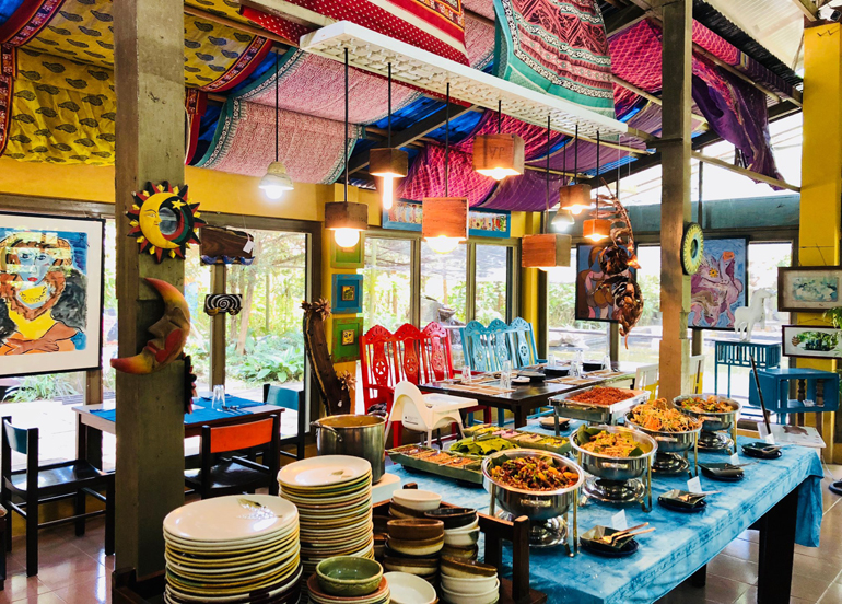 Vibrantly-colored Crescent Moon Cafe Interior with a buffet table
