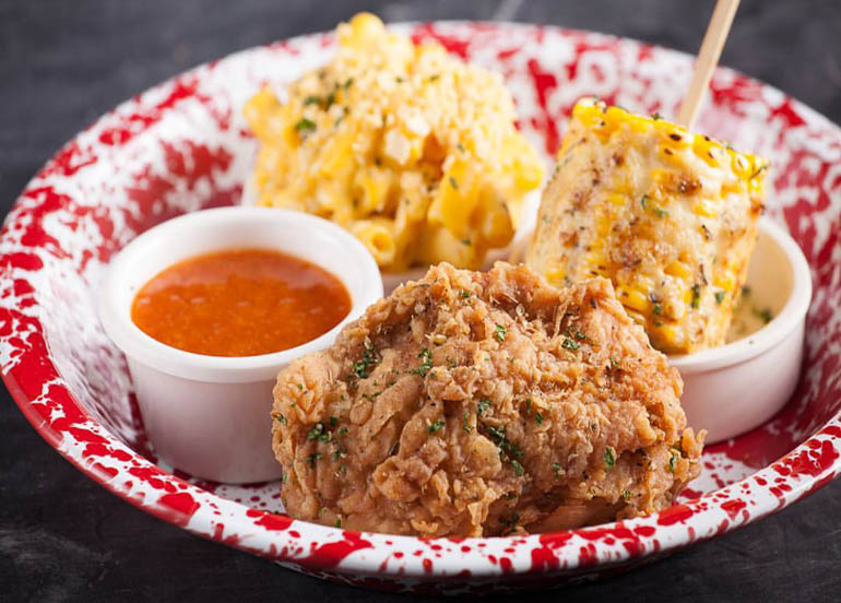 Birdhouse Fried Chicken with Elote Corn, Mac and Cheese, and Peach BBQ